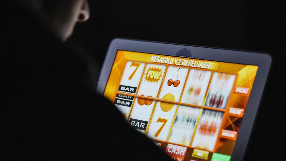 gambler playing online slots