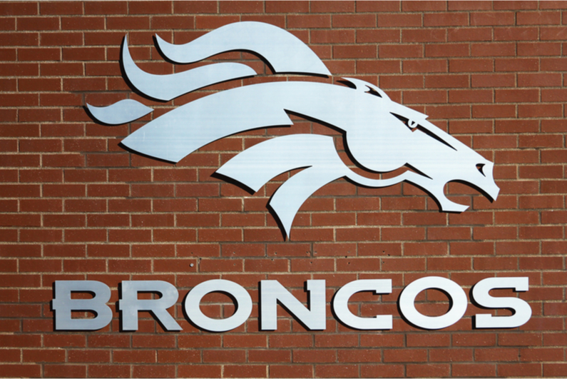 Denver Broncos logo on brick wall