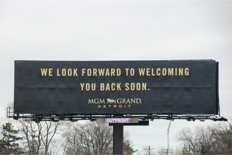 "MGM Grand Detroit billboard reading ""We look forward to welcoming you back soon"""