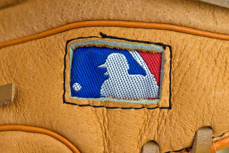 MLB logo on baseball glove
