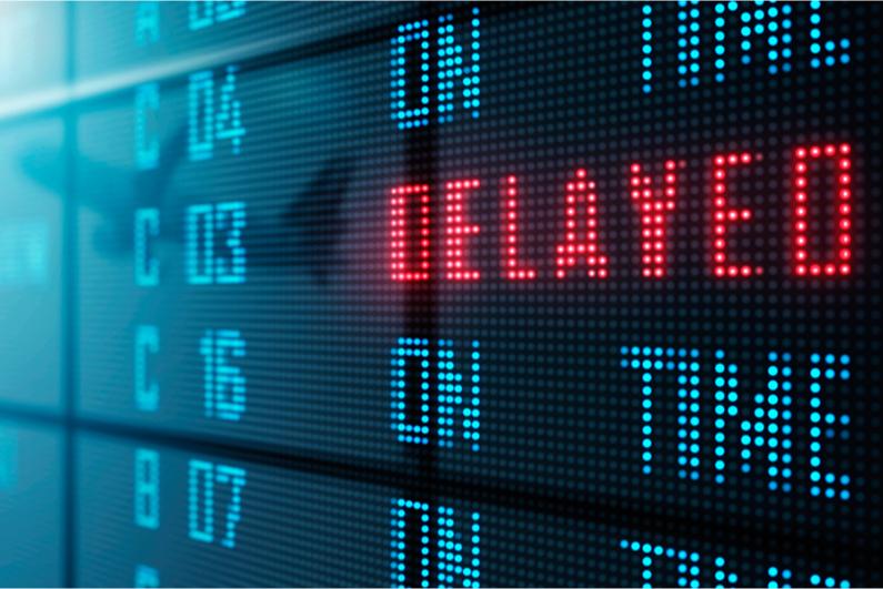"""Delayed"" notice on airport flight status board"