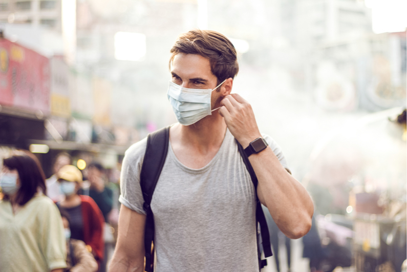 handsome man wearing a protective face mask