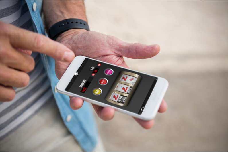 Man playing casino games on smartphone