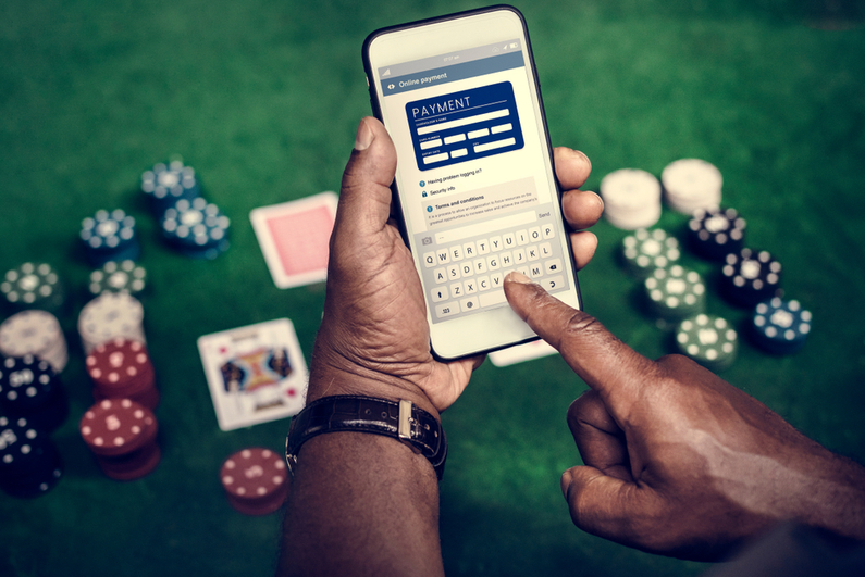 Person paying for gambling on smartphone