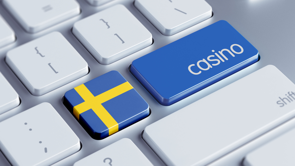"key with swedish flag and another with the word ""casino""on keyboard"