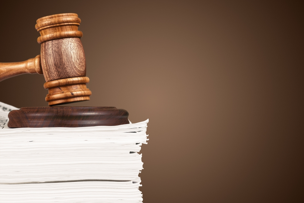 judge's gavel on top of legal documents