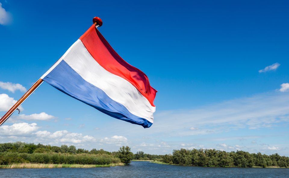 Dutch flag waving on the stern of a tour boat