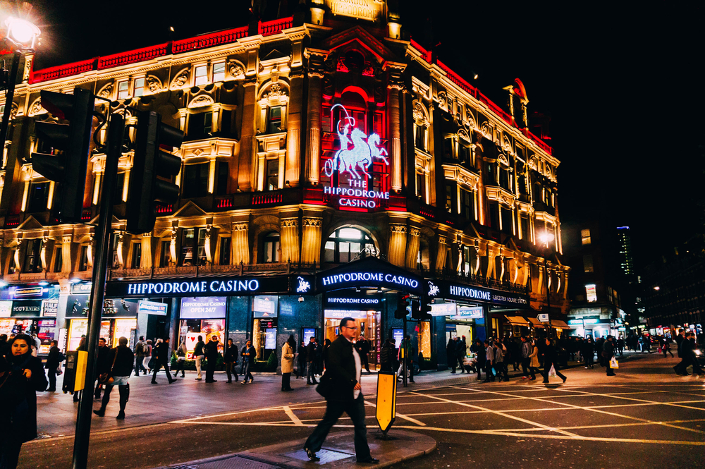 illuminated facade of a casino building in London, UK