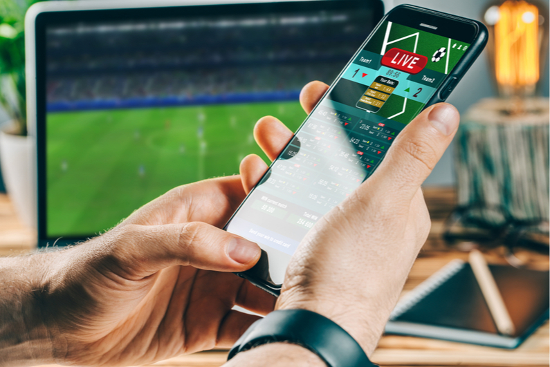 Person betting on soccer on a smartphone