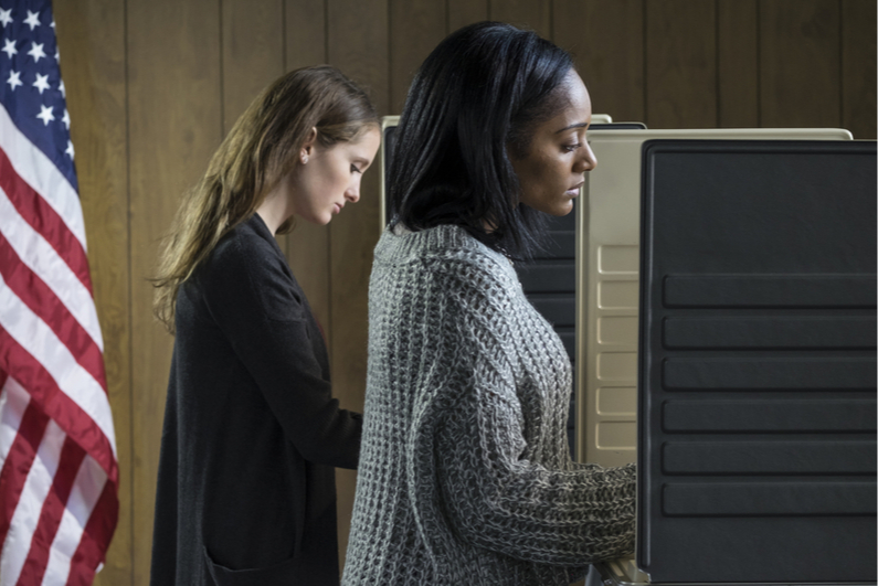 Two women voting at a polling place