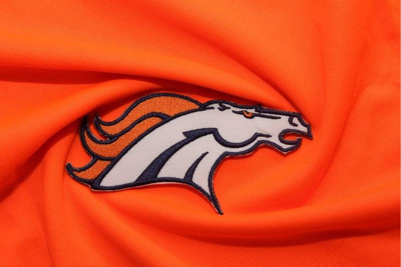 Broncos logo on orange fabric