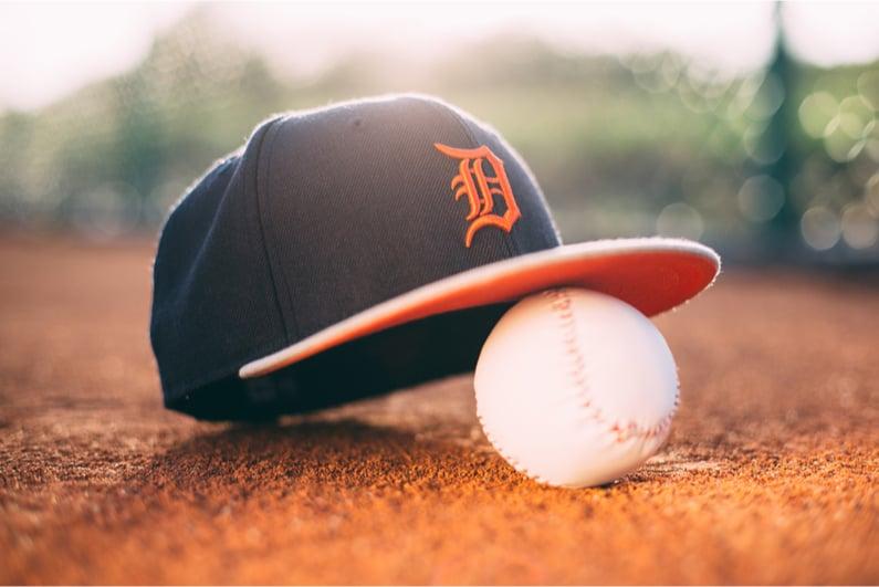 Detroit Tigers cap resting on a baseball
