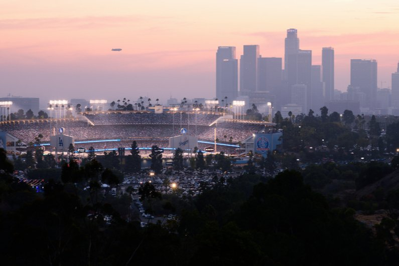 Distant view of Dodger Stadium with downtown Los Angeles in background