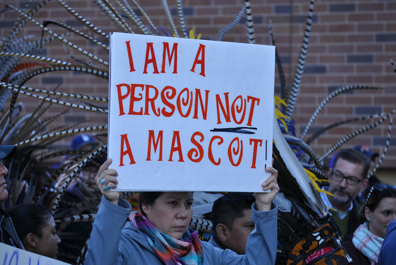Person protesting the Washington Redskins team name