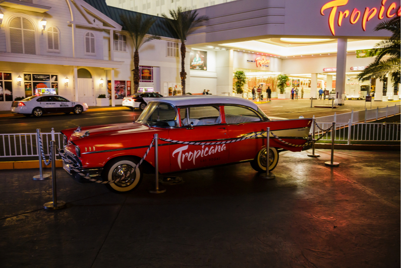 Vintage car with Tropicana logo parked in front of Tropicana Las Vegas