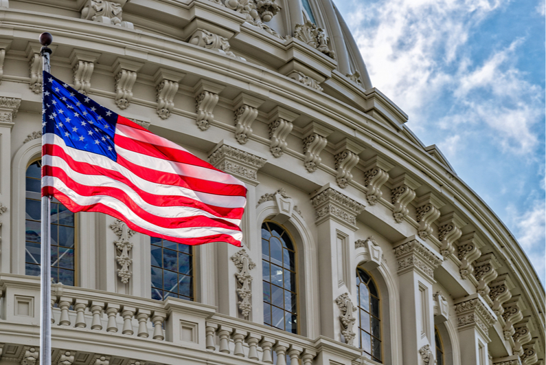 American flag flying in front of US Capitol Building