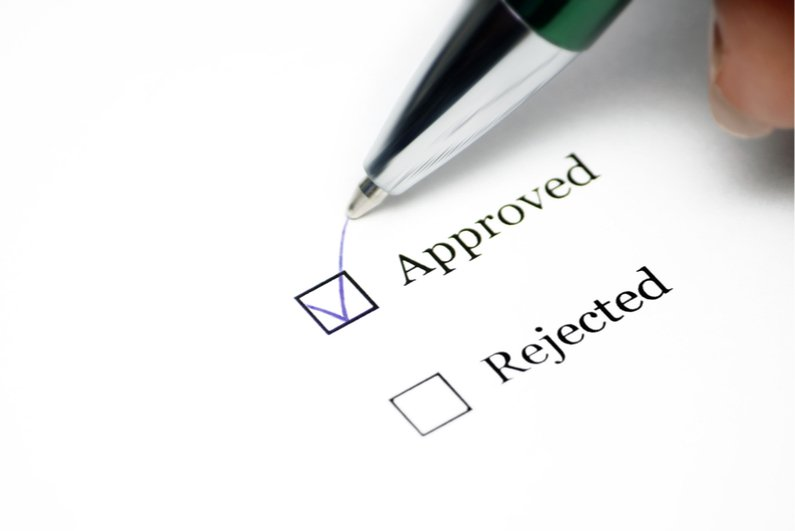 pen ticking approved box