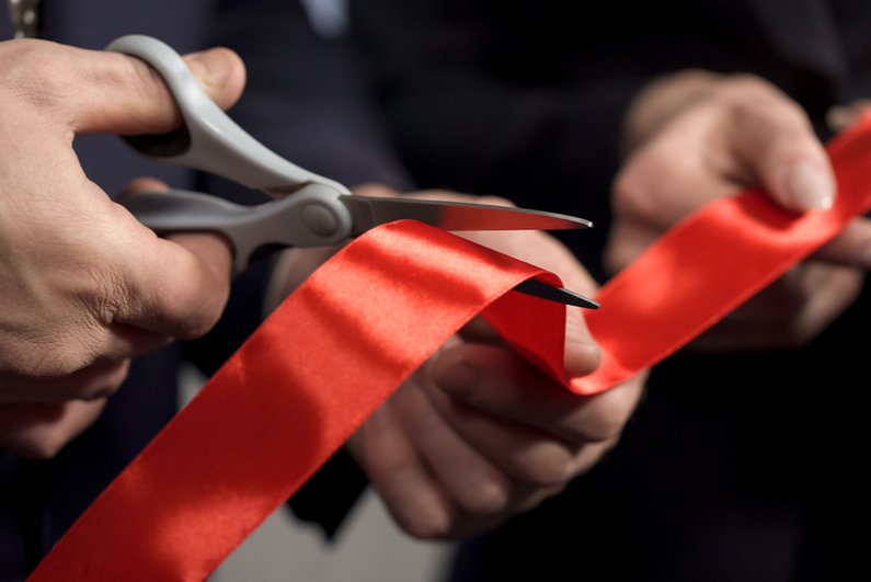 Closeup shot of ribbon cutting ceremony
