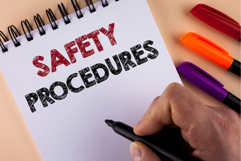 """The phrase """"SAFETY PROCEDURES"""" written on a notepad"""