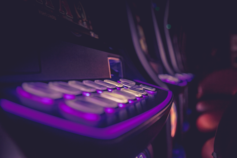 gambling machine buttons illuminated in purple