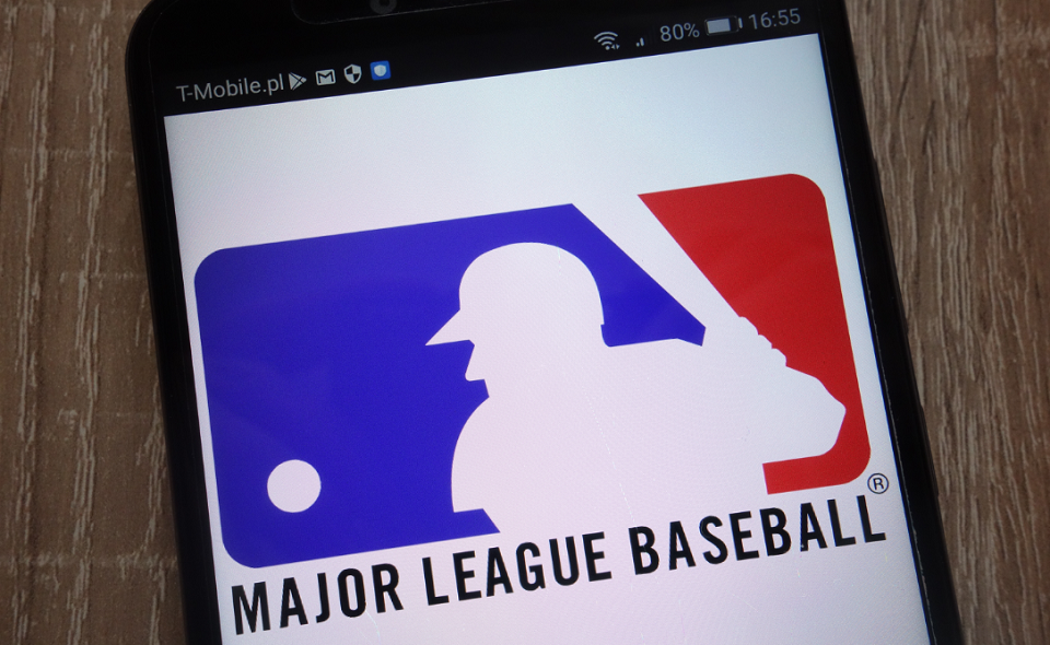 MLB logo displayed on a modern smartphone