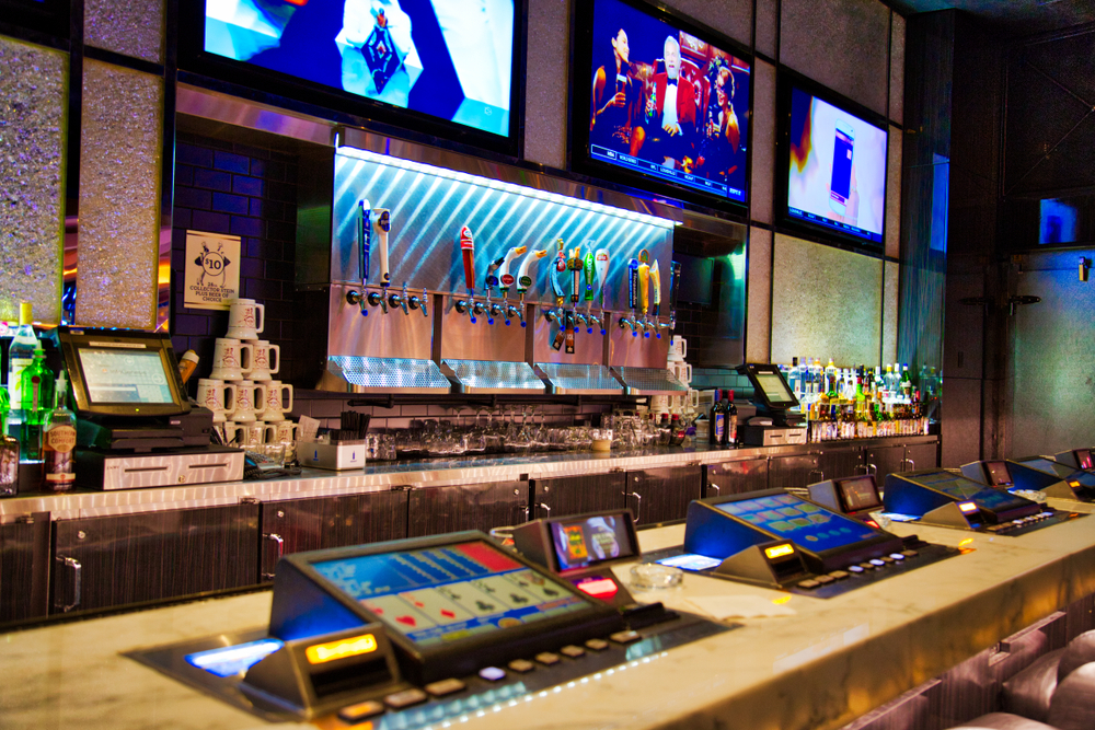 Las Vegas bar top with integrated slot machines