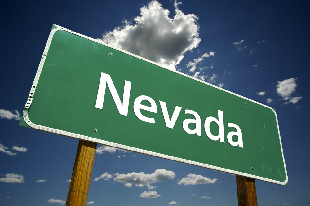 Nevada road sign against blue sky backdrop