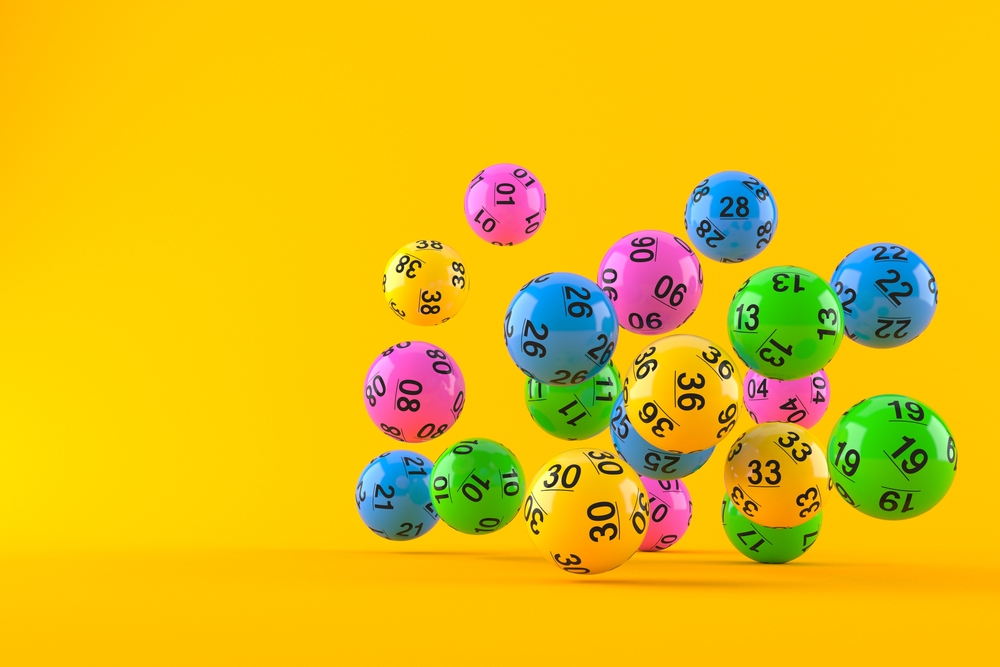 colored lottery balls against an orange backdrop