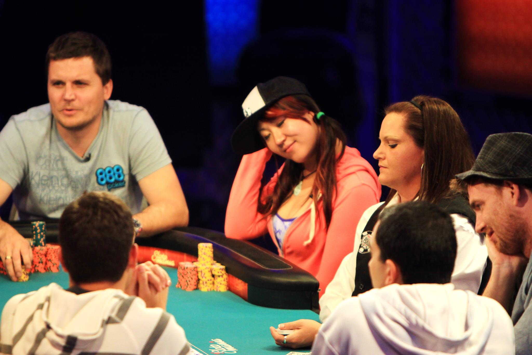 Poker pro Susie Zhao at a poker table with other players