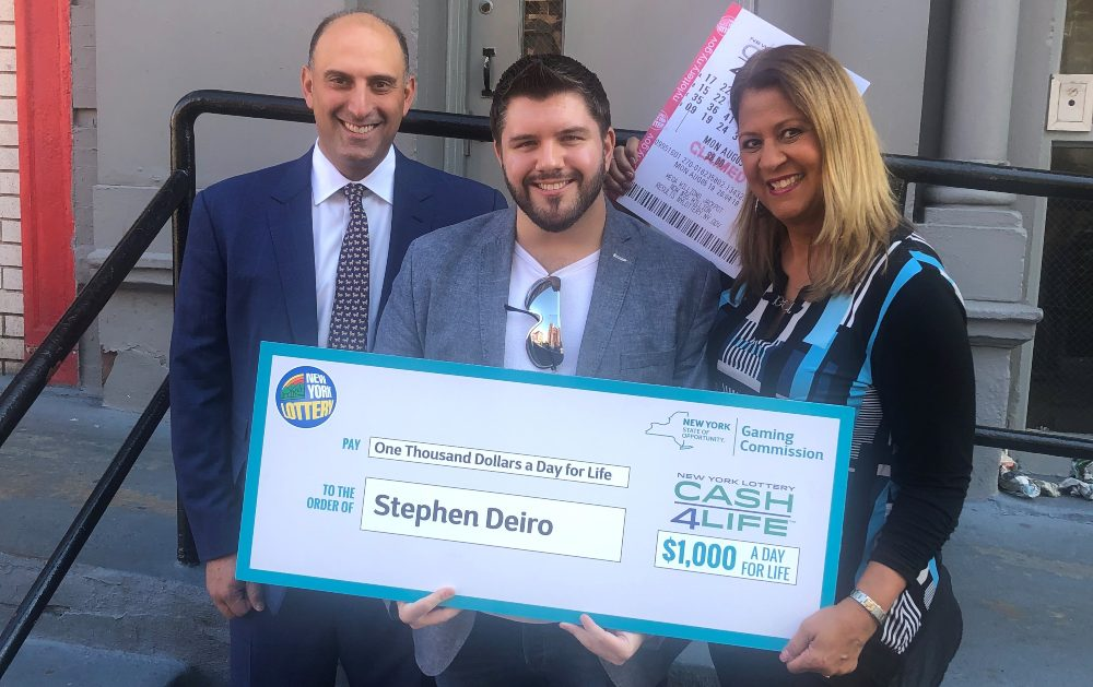Lawyer Jason Kurland posing for a photo with a lottery winner