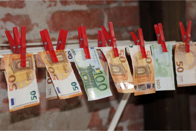 Euro bills hanging on a clothesline