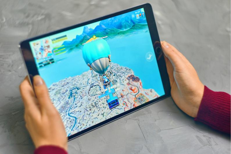 Woman playing Fortnite on an Apple iPad