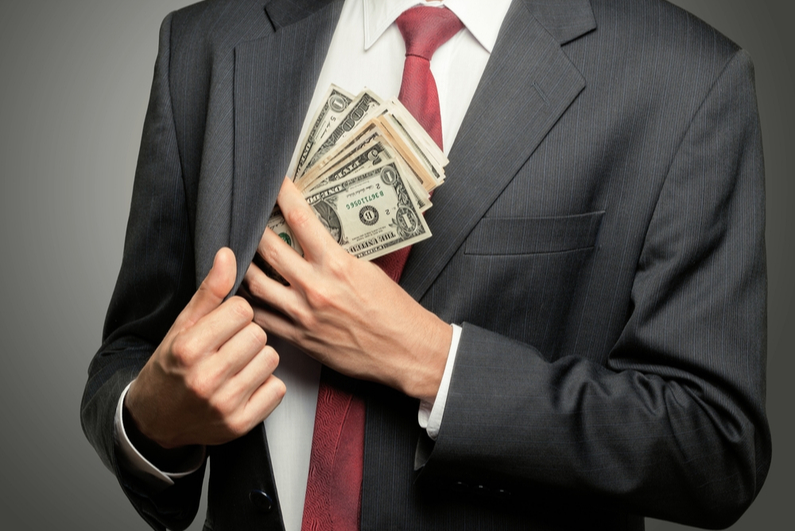 businessman pocketing cash