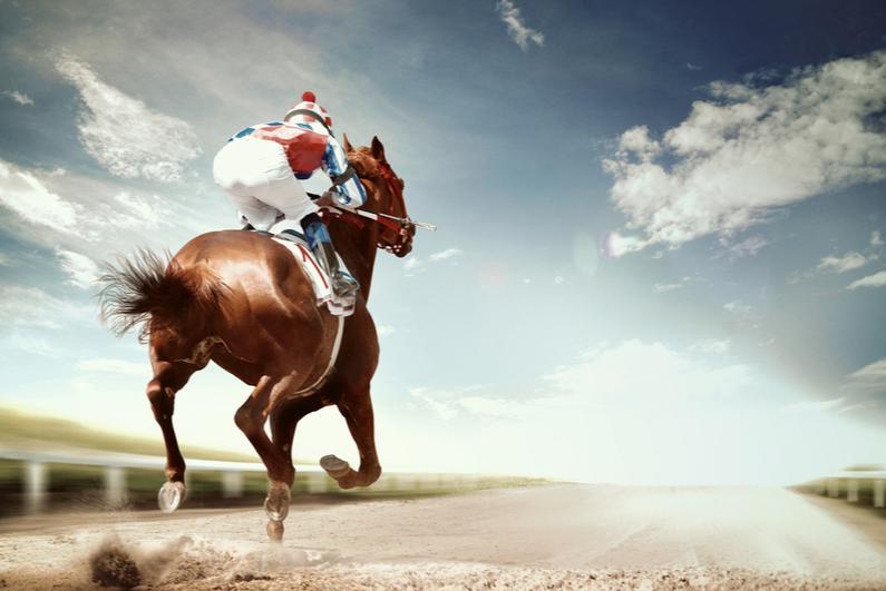 Jockey riding a horse alone