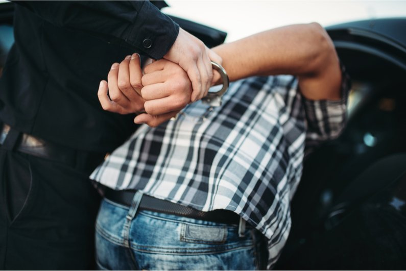 man getting handcuffed
