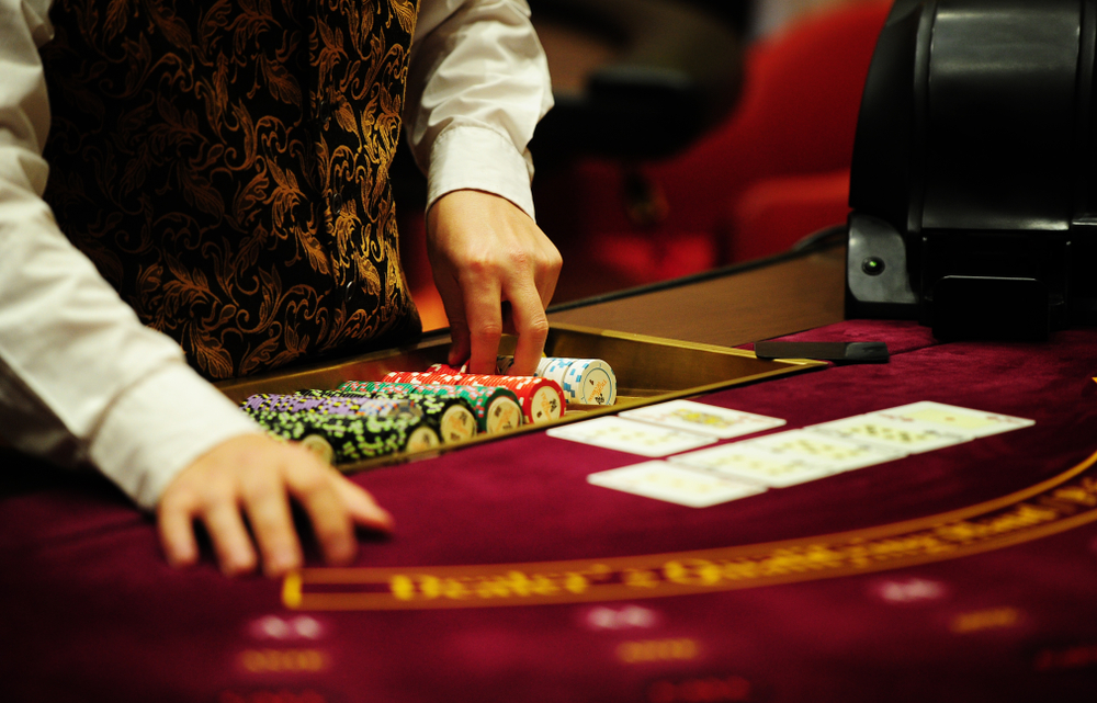 card dealer at casino poker table