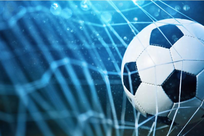 Soccer ball hitting a net