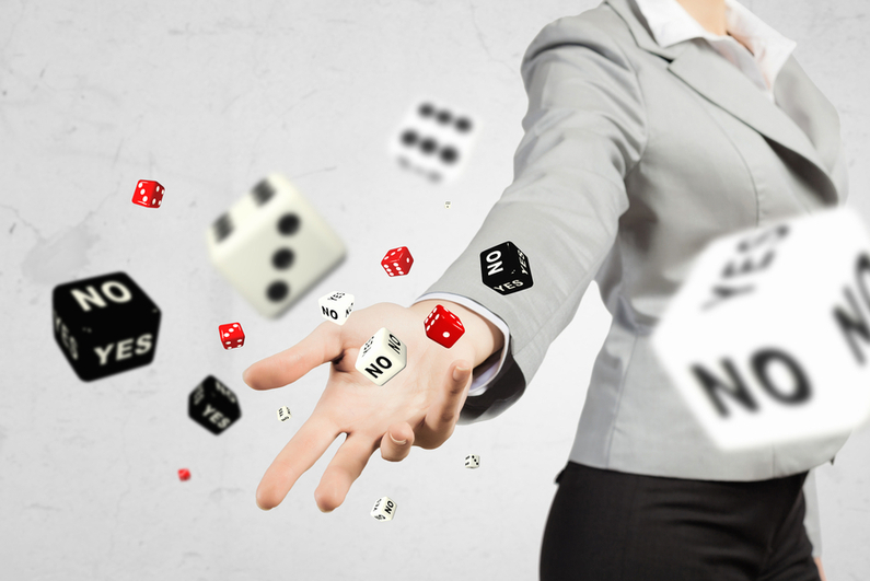 "Female businesswoman throwing standard and ""YES/NO"" dice"