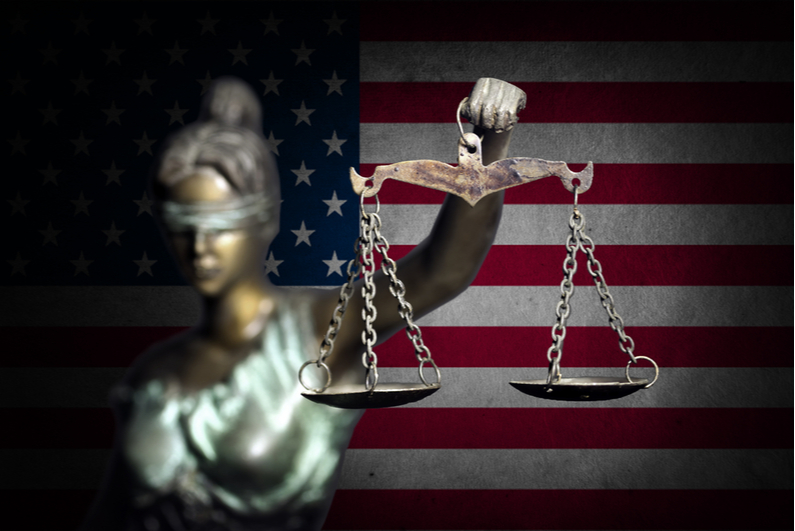 Lady Justice in front of the American flag