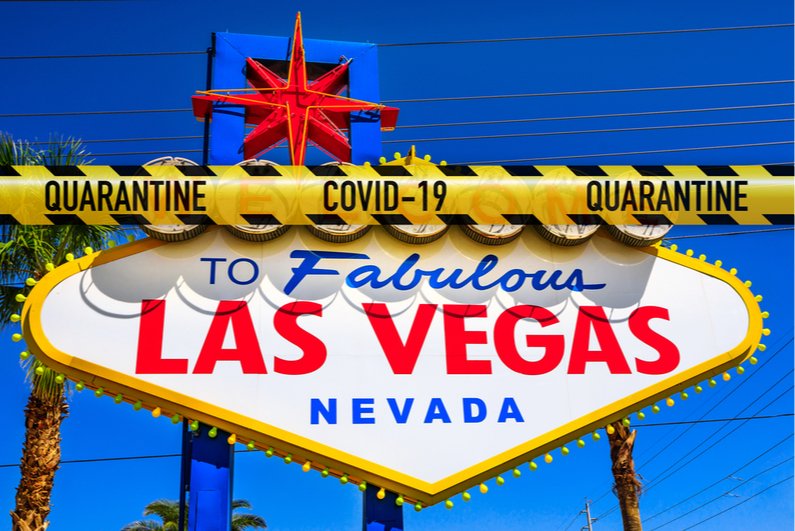 COVID-19 quarantine tape across the Welcome to Las Vegas sign