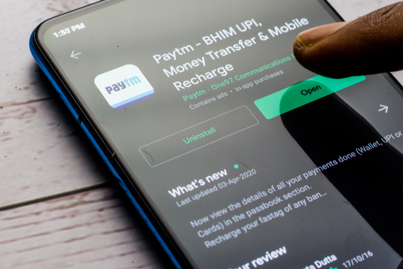 Paytm download page on a mobile phone screen