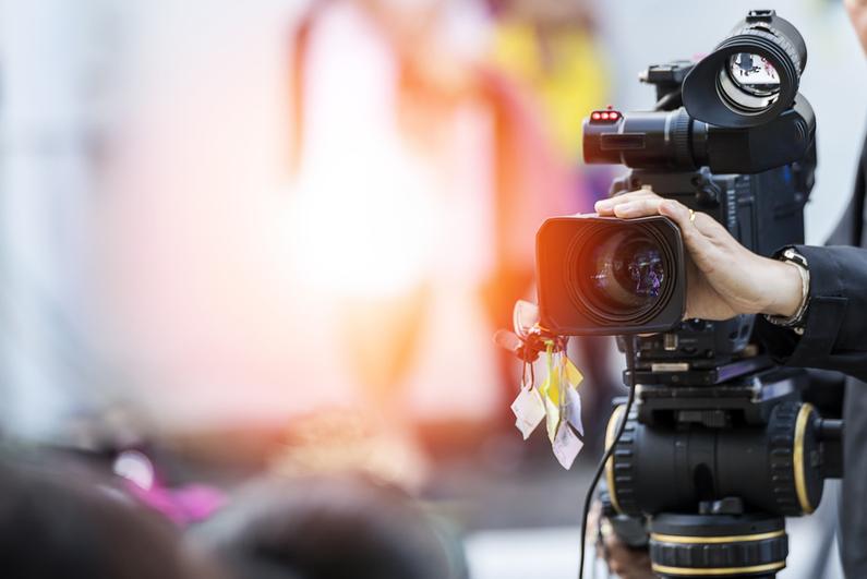 TV camera operator adjusting his camera