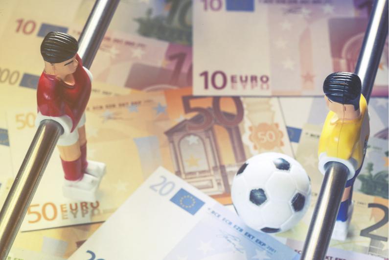 Money on a foosball table