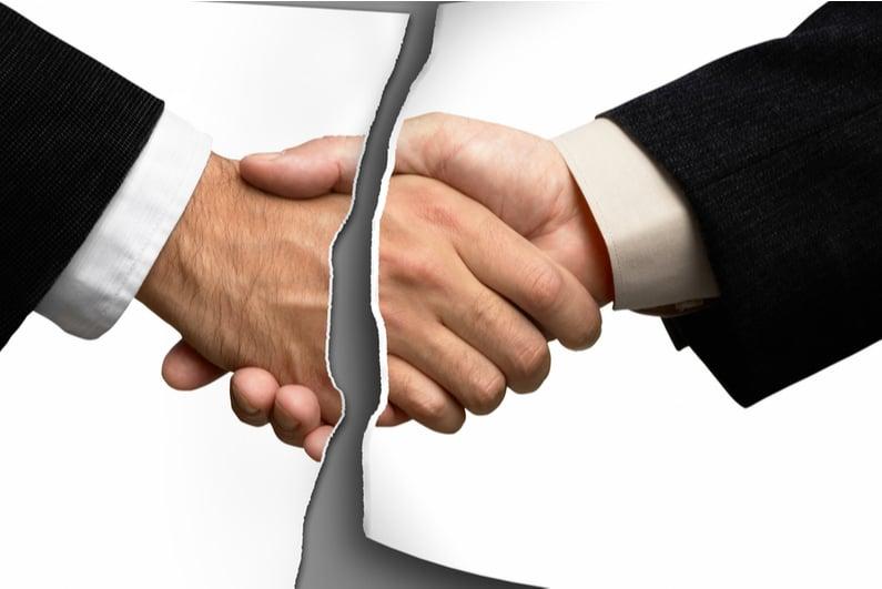 Photo of a handshake torn in half
