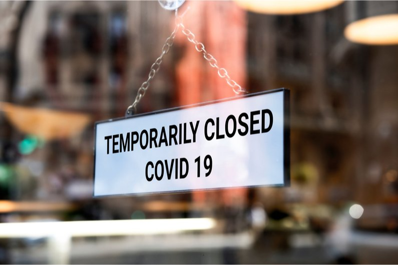 """Temporarily Closed COVID-19"" storefront sign"