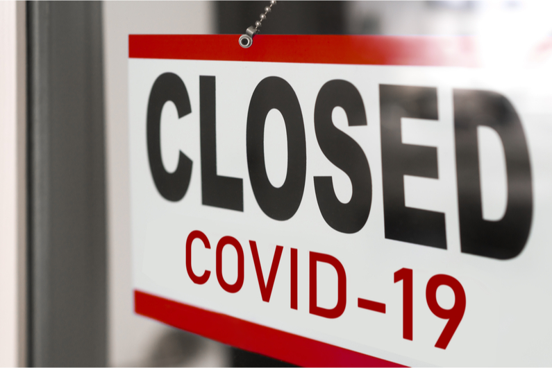 "Shop door sign reading ""CLOSED COVID-19"""