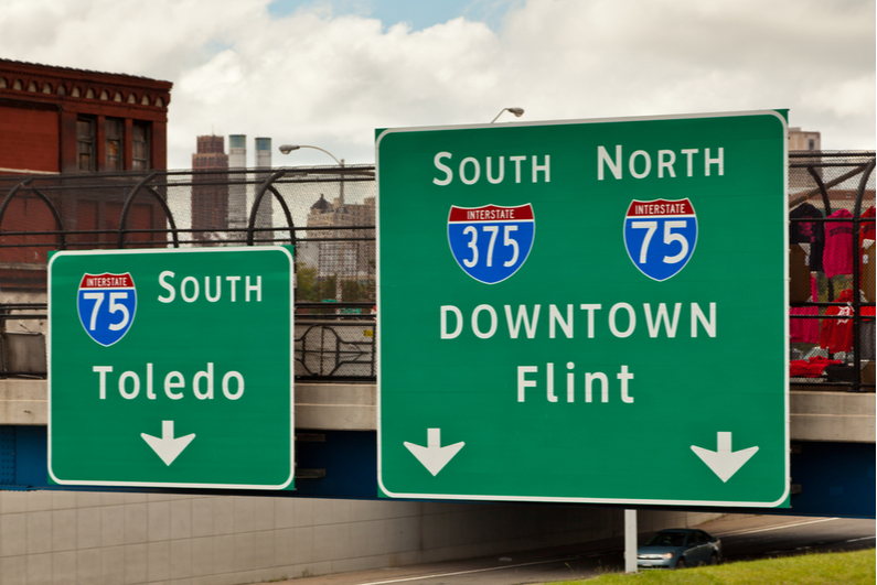Interstate highways signs pointing to Flint and Toledo