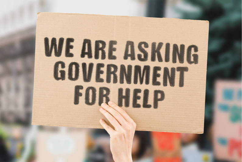 We Are Asking Government for Help cardboard sign