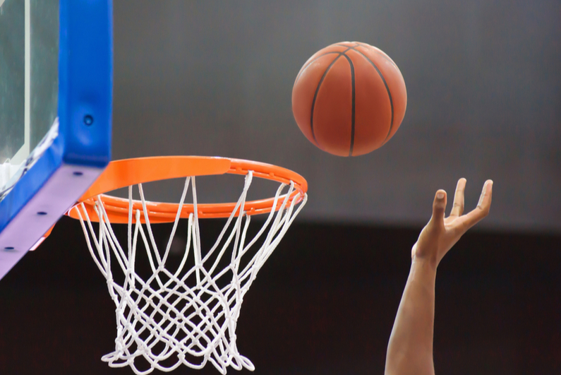basketball player going for a tip-in