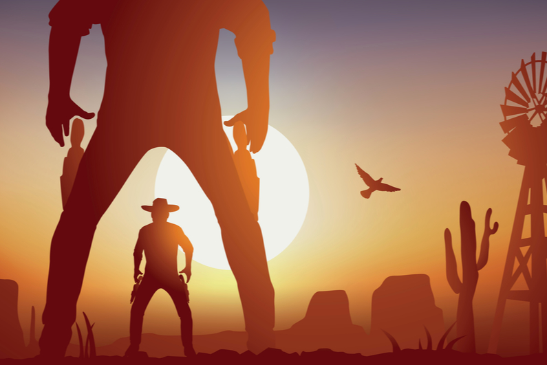 Cowboy showdown at sunset